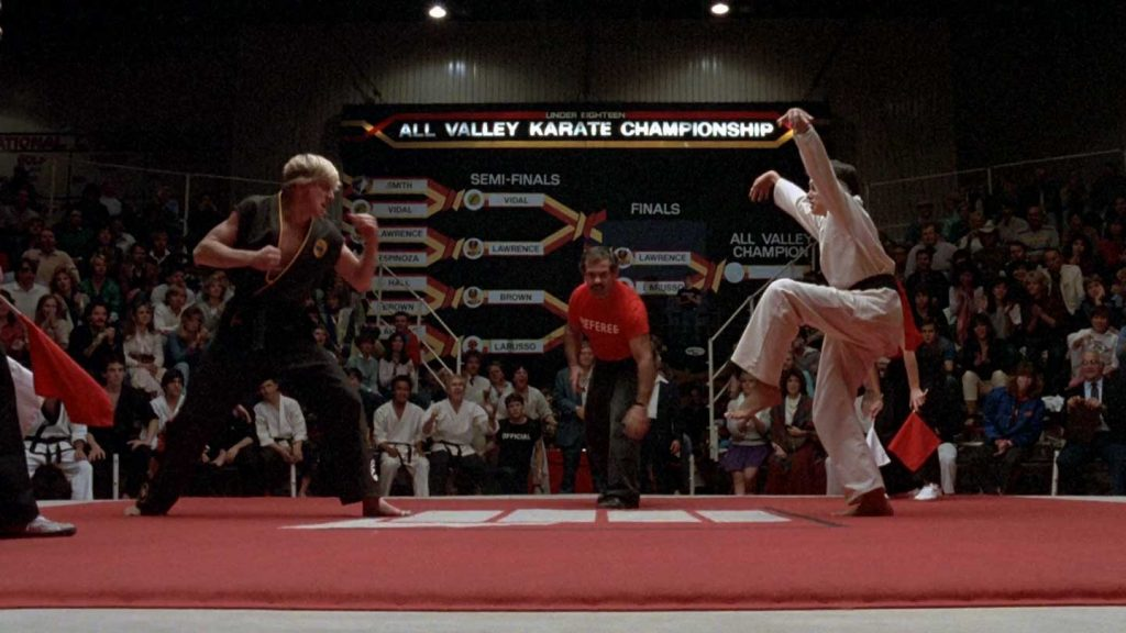 Johnny e Daniel lutando em Karatê Kid